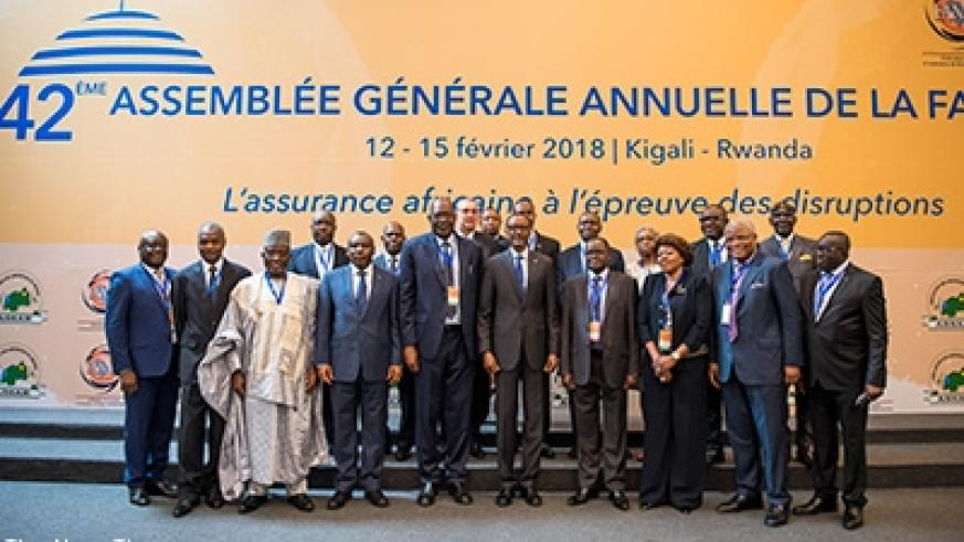 President Kagame in a group photo with some of the delegates attending the 42nd General Assembly of the Federation of African National Insurance Companies in Kigali yesterday. Vill....