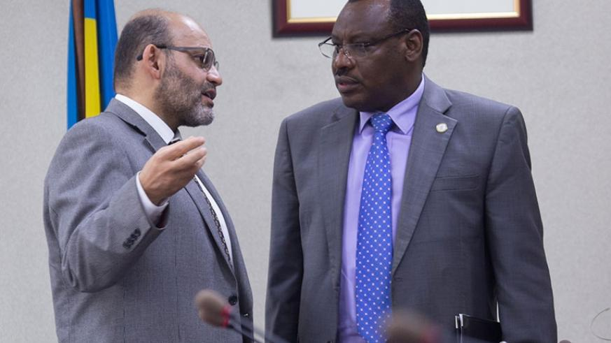 Yasser El Gammal, the World Bank Country Manager for Rwanda, chats with Finance minister Claver Gatete at a past event. Timothy Kisambira.
