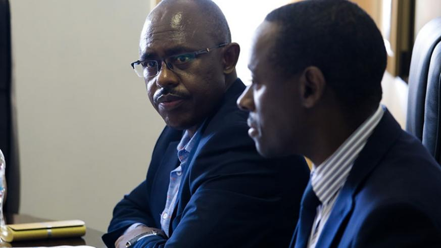 Minister Mutimura (L) before the lawmakers yesterday. Timothy Kisambira.