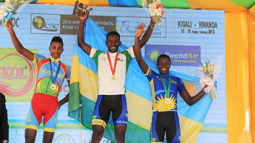 Joseph Areruya (C), Didier Munyaneza (R) and  Henock Mulueberhan display  their medals after winning during the African Road Race Championship in Kigali yesterday. Samuel Ngenadahimana.