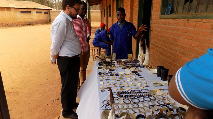 A group of students from Groupe Scolaire   Kicukiro taking part in the programme explain how they make jewels from cow corns. / Diane Mushimiyimana.