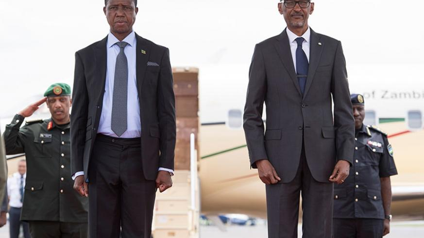 Presidents Paul Kagame and Edgar Lungu shortly after the Zambian leader's arrival at Kigali International Airport yesterday. President Lungu is in Rwanda for a two-day state ....