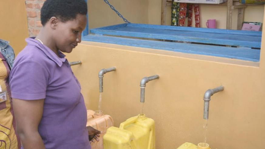 A Rutsiro residents fetches water from a tap. File.