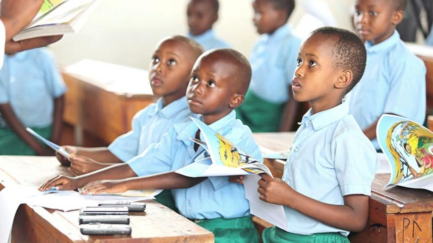 EP Kamashashi pupils listen to officials on the occasion of International Mother Tongue Day celebrations in Kicukiro District on Thursday. At the event, USAID, through its project,....