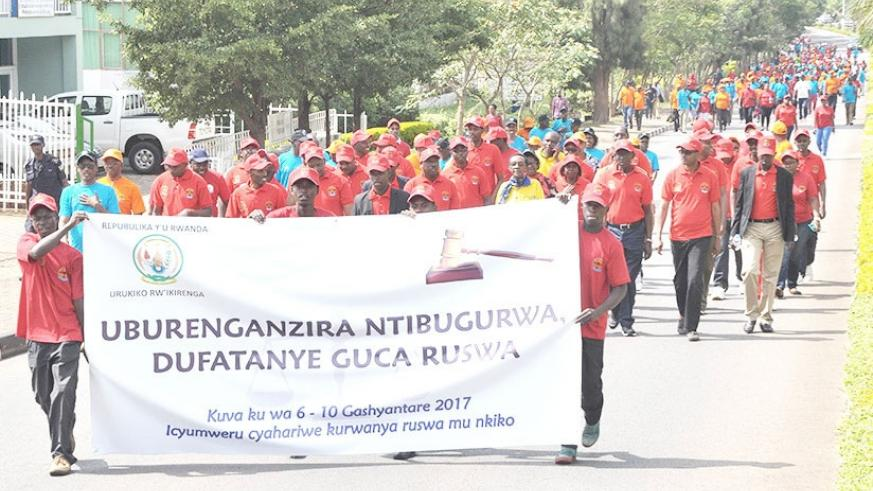 Personnel in judiciary march during an anti-corruption campaign last year. File.