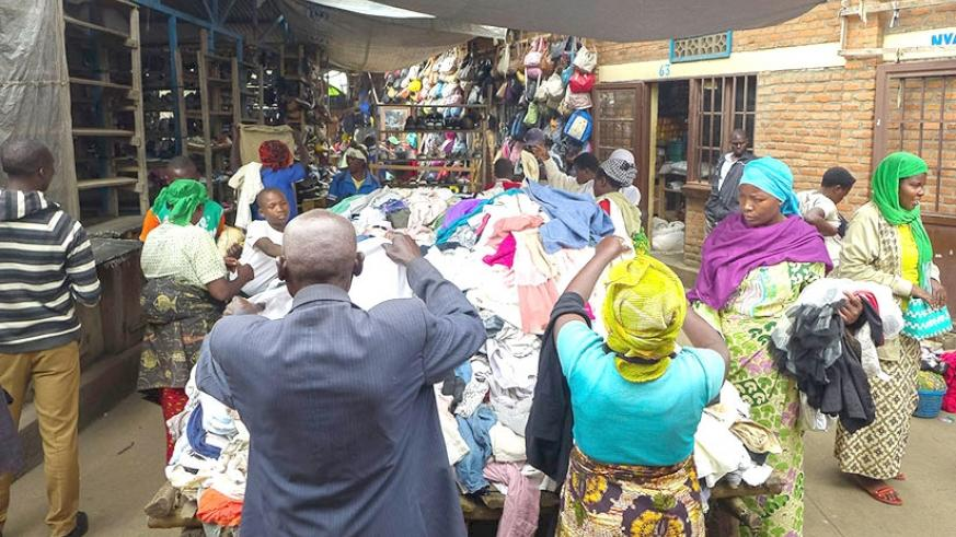 Vendors and prospective buyers sort used clothes in Rubavu's Mahoko market. File