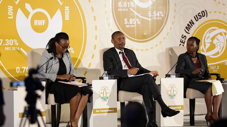 Central Bank Governor John Rwangombwa (C) speaks at the meeting as Peace Uwase Masozera, Executive Director Financial Stability (L), and Vice-Governor Monique Nsanzabaganwa look on....