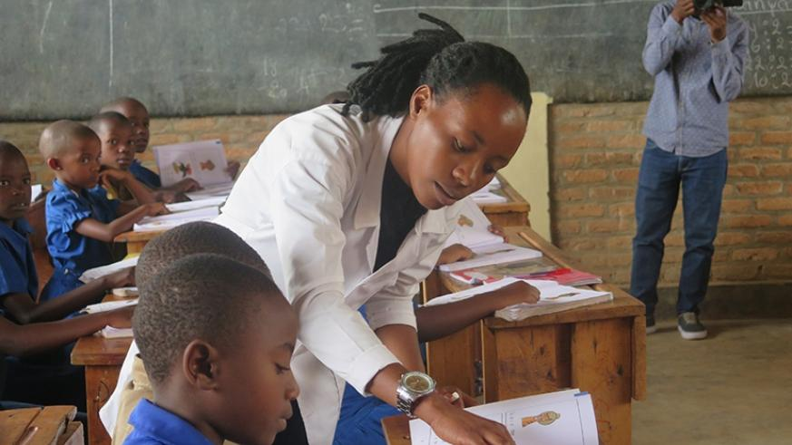 A teacher engages students in a lesson as EDT officials toured to assess the challenges facing teachers during their teaching practices. Eddie Nsabimana.