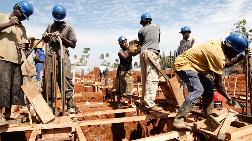 Casual labourers at a construction site in Kigali. Some workers at construction sites don't wear protective gear which puts their safety in jeopardy. Timothy Kisambira.