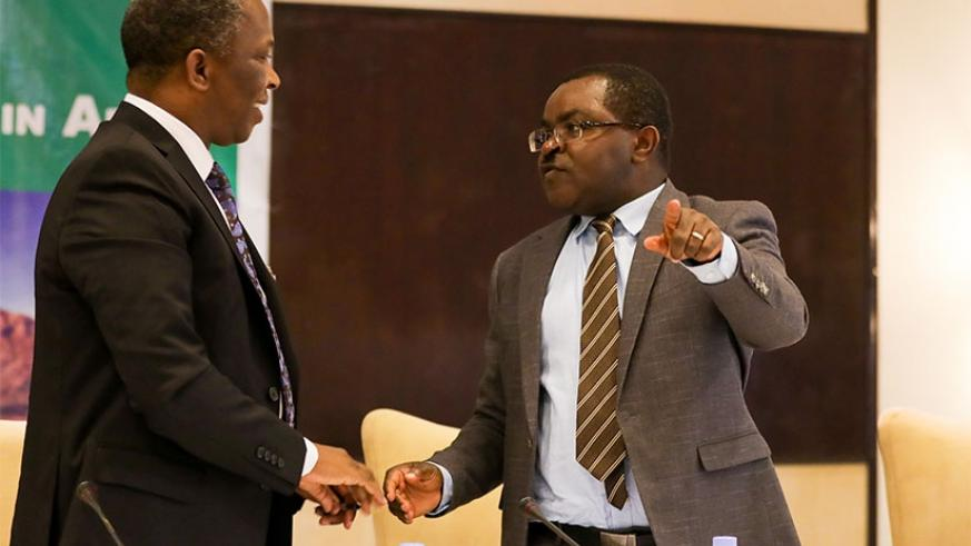The Swazi Minister for Commerce, Industry and Trade Jabulani C. Mabuza (L) chats with Rwandan Minister for Trade and Industry, Vincent Munyeshyaka, at the meeting in Kigali yesterd....