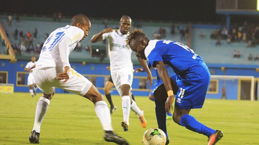 Rayon Sports forward Shaban 'Shabalala'  Hussein (right) tries to go past Mamelodi Sundowns defender Morena Thapelo. Sam Ngendahimana.