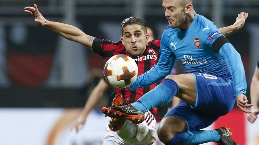 Jack Wilshere competes for the ball against Ricardo Rodriguez as Arsenal were largely comfortable against a poor Milan side. Net photo