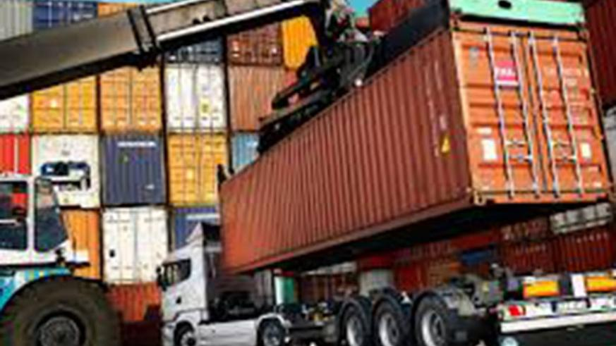 cargo container being   loaded on a truck at Dar port