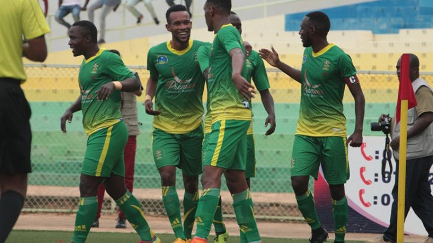 AS Kigali celebrate after taking the lead against Musanze FC on Monday. The hosts won the game 4-3 to return to top of the league table. Courtesy