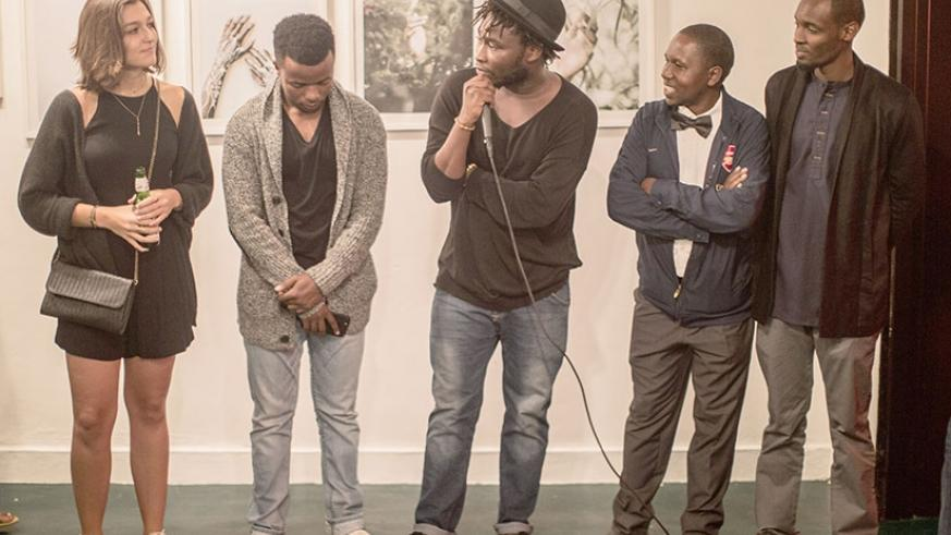 Jacques Nkinzingabo (centre) introduces some of the participating   photographers at the opening ceremony in December last year.