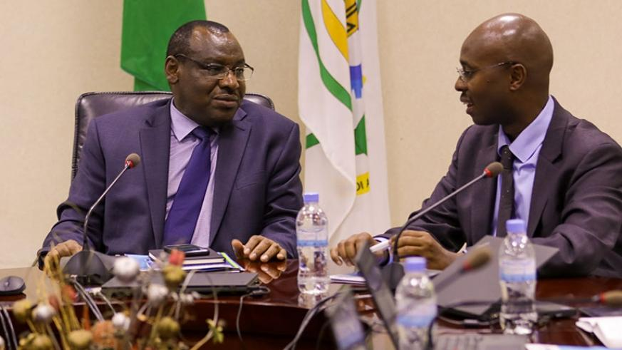 The Minister for Finance and Economic Planning, Amb. Claver Gatete (L), chats with Yusuf Murangwa, Director-General, National Institute of Statistics of Rwanda in Kigali yesterday ....