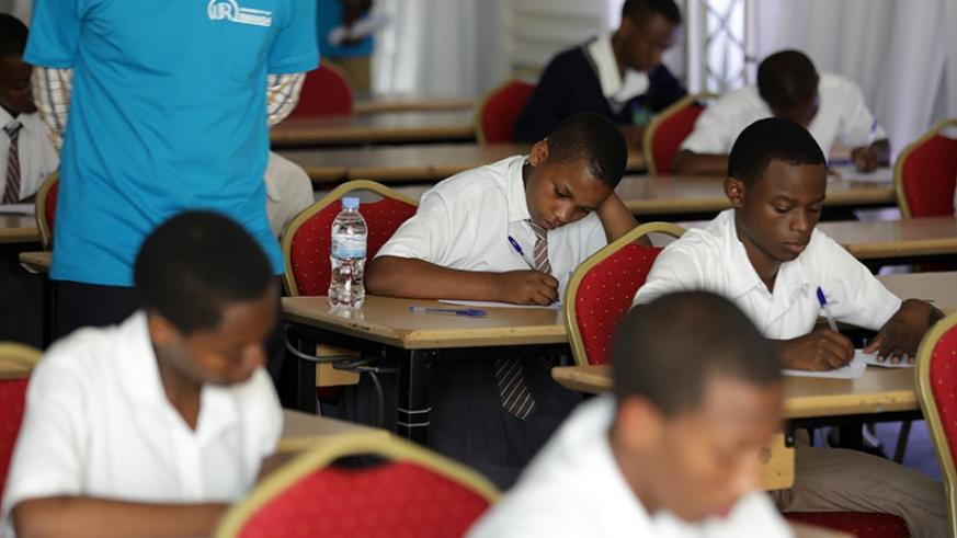Students sit an examination during a Mathematics competition that attracted students from 10 science secondary schools in the country, yesterday.(Timothy Kisambira)