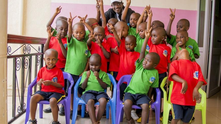 Nkusi poses for a group photo with visually impaired children under the care of Jordan Foundation. (Courtesy photos)