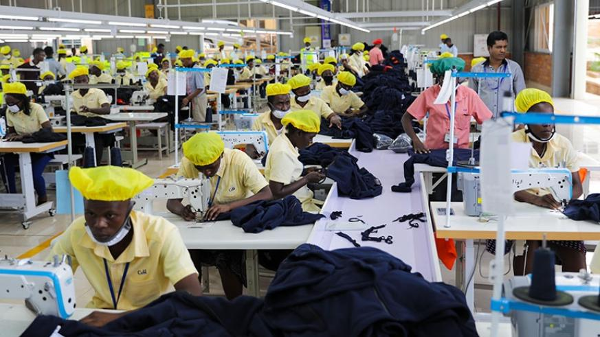 Workers at C&H garment factory at the Kigali Economic Zone making outfits. The continental free trade agreement, to be signed on Wednesday, is meant to ease movement of goods acros....