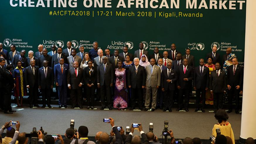 Delegates pose for a group photo after the opening session of the Executive Council of Ministers of African Union meeting in Kigali. Timothy Kisambira.