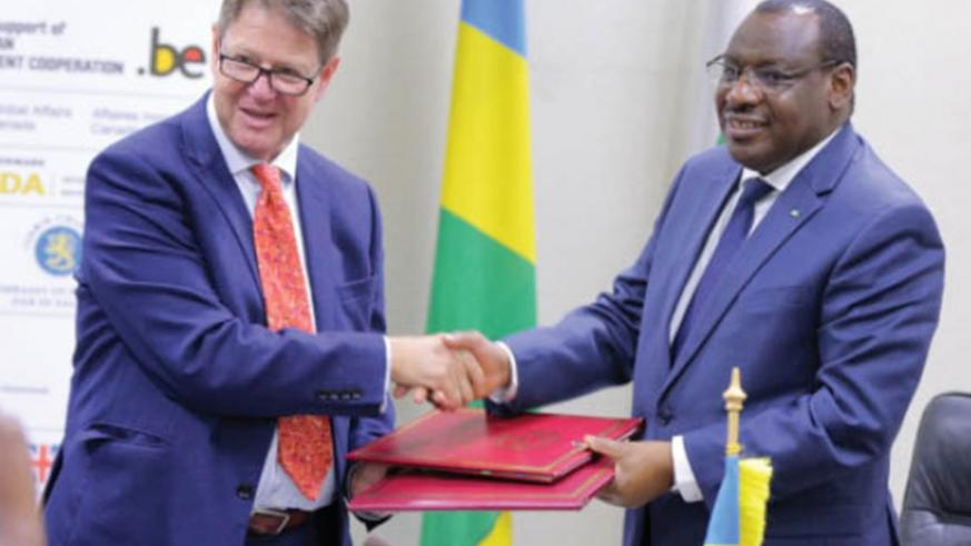 Gatete (R) and Matsaert after signing the agreement.  (Courtesy)
