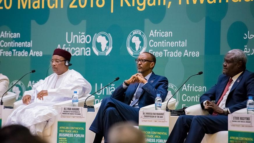 President Kagame with the President of Niger and Champion of the CFTA Process, Mahamadou Issoufou, and  the Chairperson of the African Union Commission, Moussa Faki Mahamat, at the....