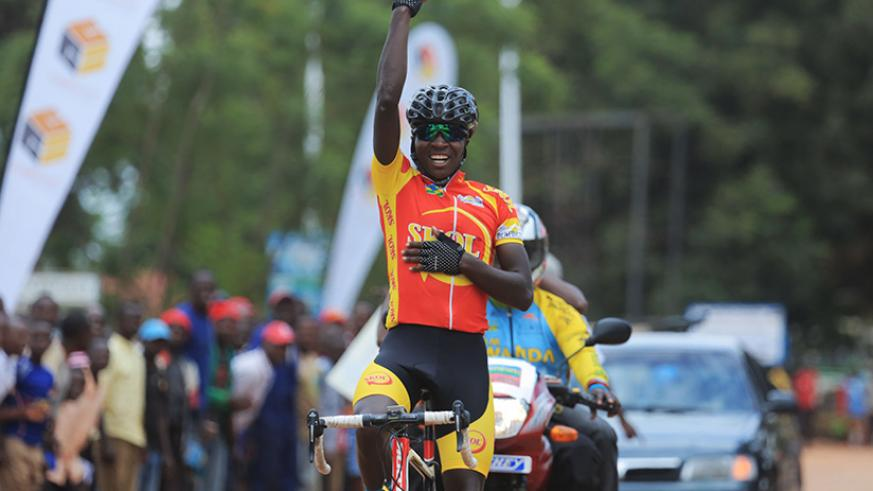 Benediction Club's youngster Didier Munyaneza celebrates his solo finish of Memorial Byemayire Lambert race in Huye yesterday. Sam Ngendahimana.