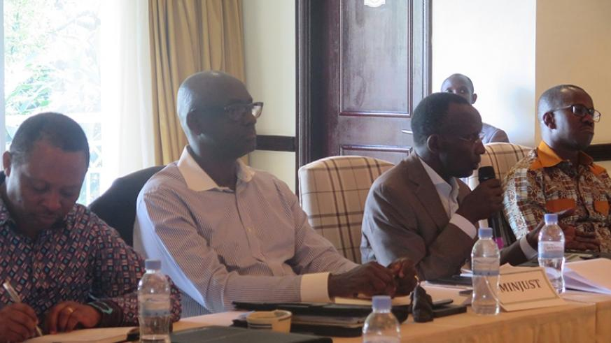 Chief Justice Sam Rugege speaks as Justice minister Johnston Busingye (second left), State minister for Constitutional and Legal Affairs Evode Uwizeyimana (extreme right) and RGB c....