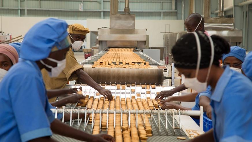 Workers at ADMA Biscuit factory in Kigali. Debate on retirement age continues. / Timothy Kisambira.