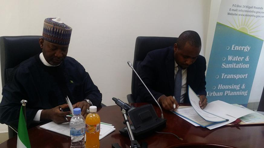 Jean de Dieu Uwihanganye, Rwanda's state minister for transport (R) and his counterpart Hadi Abubakar Sirika, Nigerian state minister in charge of aviation append airspace agreemen....