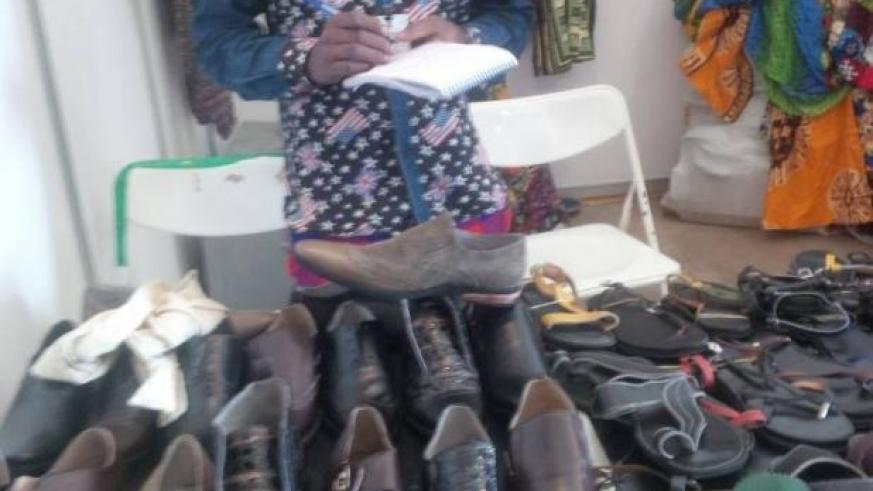 A shoe-maker waits for buyers. Business owners need learn money handling skills. / File.