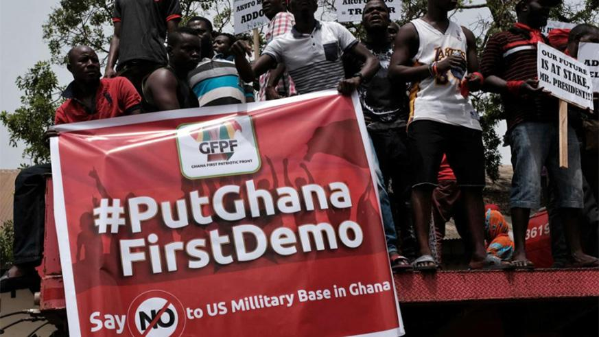 Demonstrators carry banners during a protest in Ghana's capital Accra against the expansion of its defence cooperation with the United States, Ghana March 28, 2018. / Internet photo