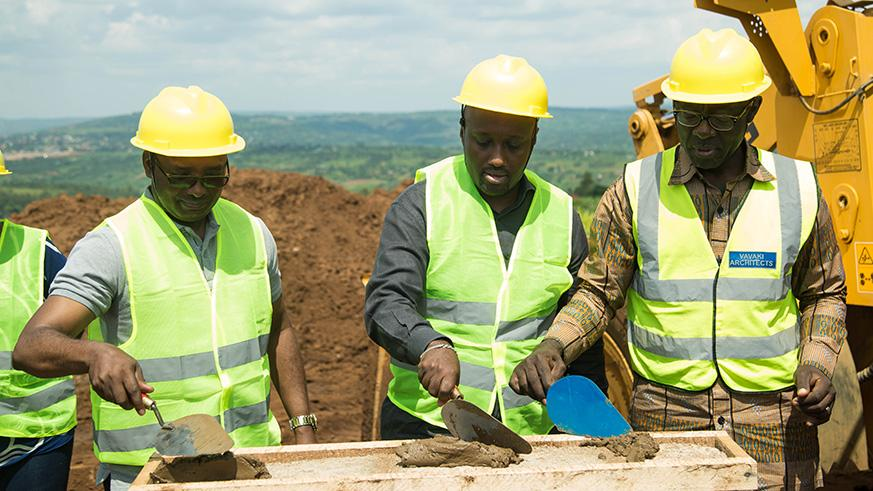 L-R City of Kigali Mayor Pascal Nyamulinda, Olivier Nduhungirehe, Minister of State in the Ministry of Foreign Affairs, Cooperation and East African Community and city businessman Denis Karera during the ground breaking ceremony that will see the construction of 1040 housing units in Busanza sector. / Nadege Imbabazi