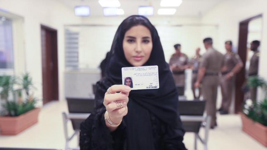 Esraa Albuti, an Executive Director at Ernst & Young, holds her new driving licence issued by the Kingdom of Saudi Arabia. / Internet photo