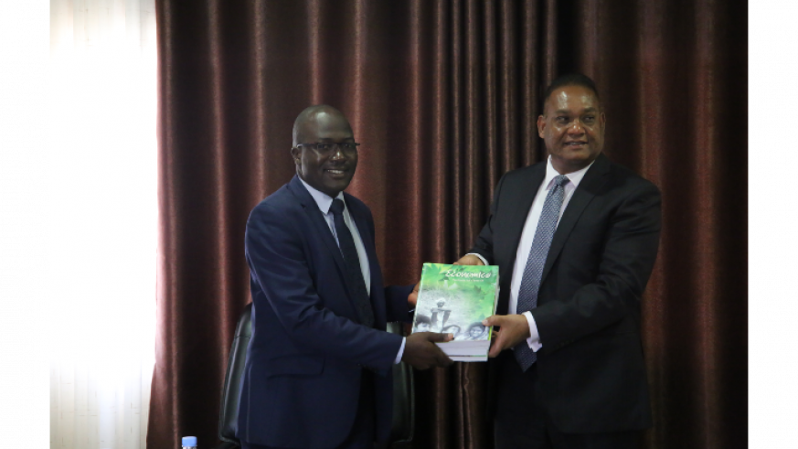 Director General of REB receiving books from India's Envoy to Rwanda/Craish Bahizi