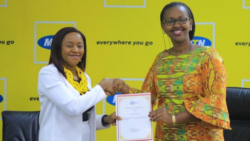 MTN Rwanda CEO Mitwa Ng'ambe (L) and RSSB's Deputy Director General in charge of benefits, Dr. Hakiba Solange (R) during the announcement of the MTN Rwanda subsidy towards Mutuelle de Sante at their headquarters on Wednesday